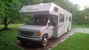 An Rv Rental Parked For Camping