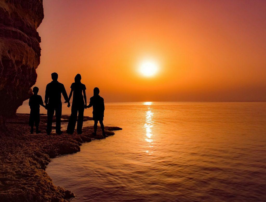 Family enjoying sunset while on vacation